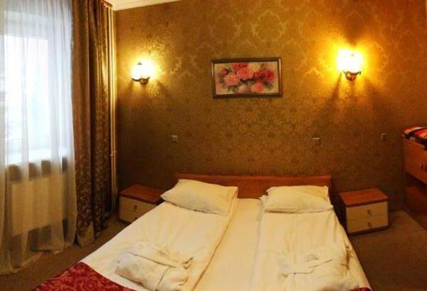 Первоклассная двуспальная кровать в отеле Терем