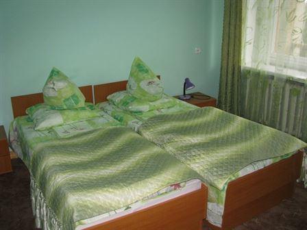Ліжко в номері люкс Санаторій Любінь Великий
